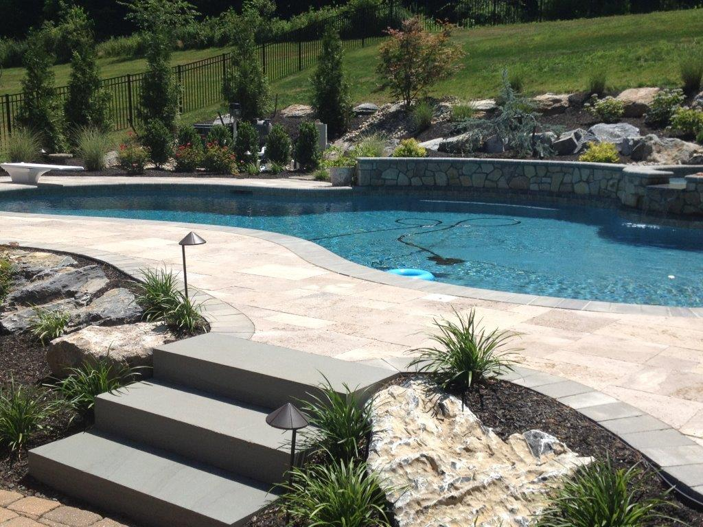 Bluestone Block Steps with Travertine Pool Paving and Bluestone Coping